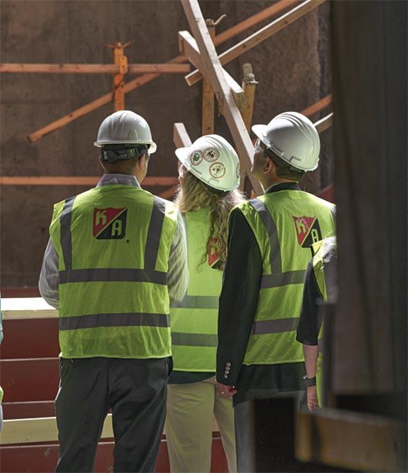 Three KA workers inspect a site
