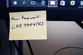 password written on a post it note on a computer