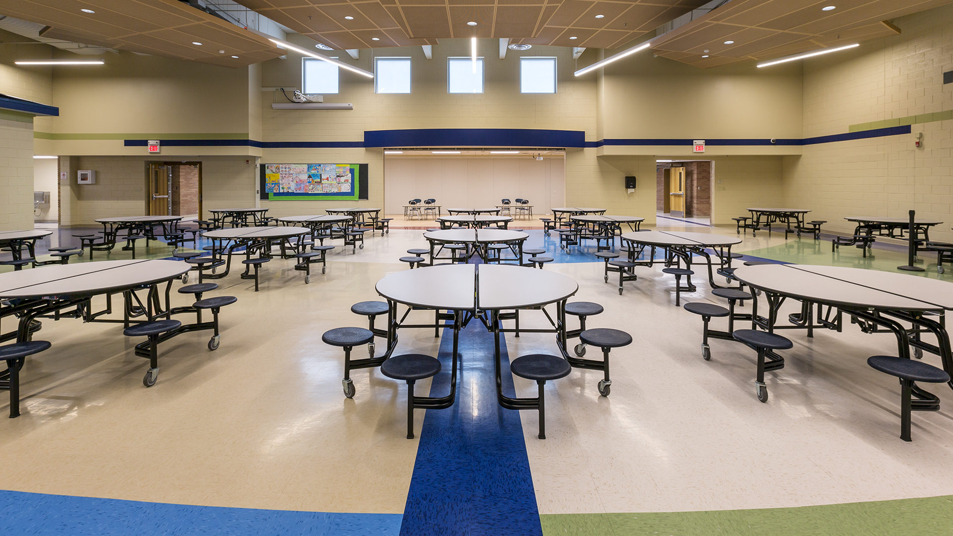 Clear Lake Elementary School Interior Cafeteria filled with Round Tables