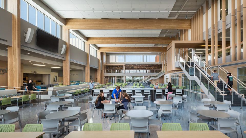 Alexandria High School Interior Cafeteria With Many Tables, Booths and Communal Seating