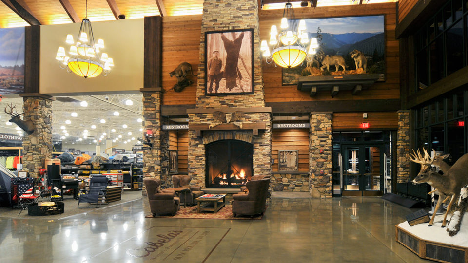 Testimonial Cabelas Retail Center Sun Prairie WI Interior Lobby Seating Area With Leather Chairs in Front of Fireplace
