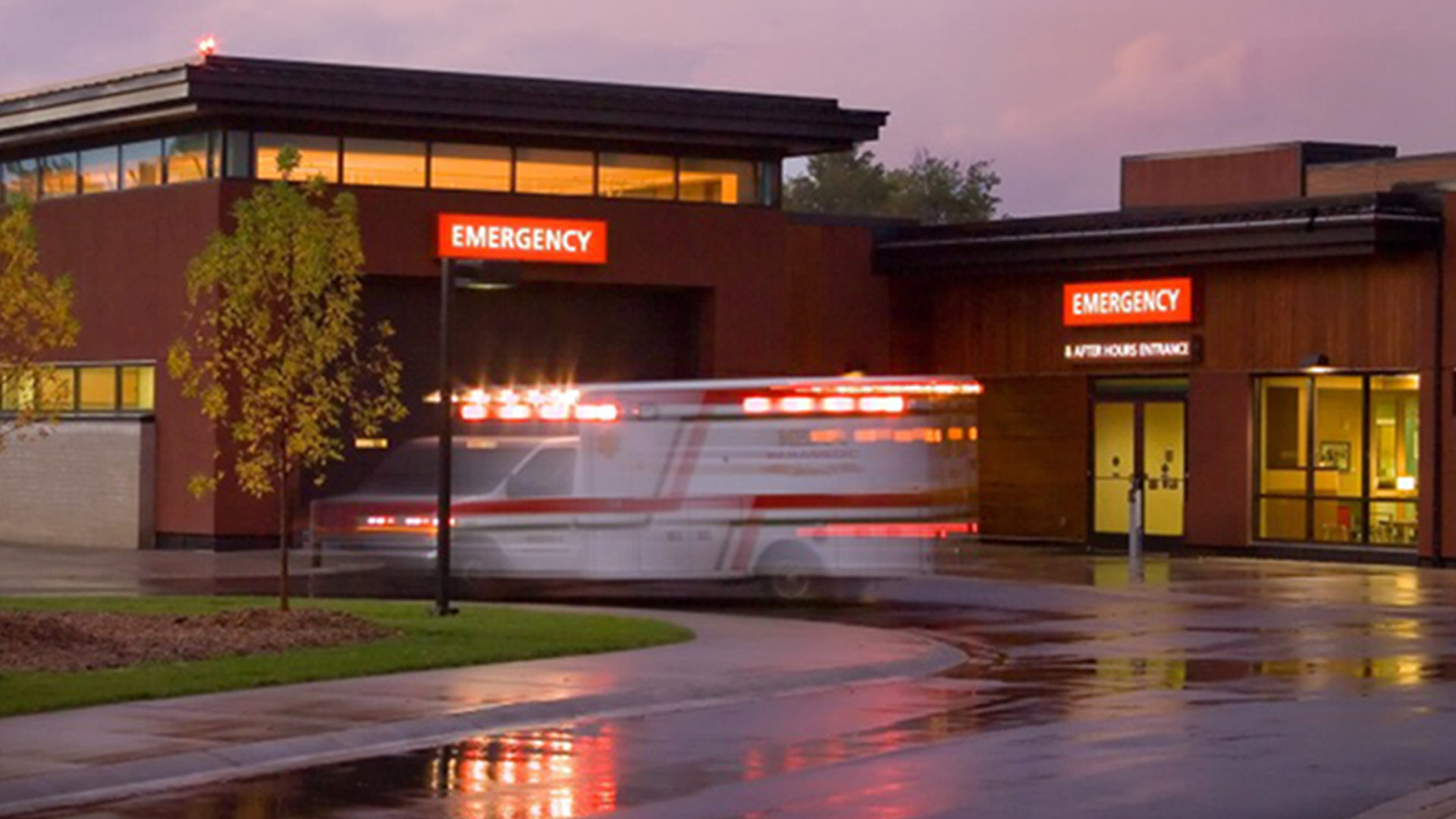 Grand Itasca Clinic & Hospital Night Exterior View of Emergency Entrance with Ambulance