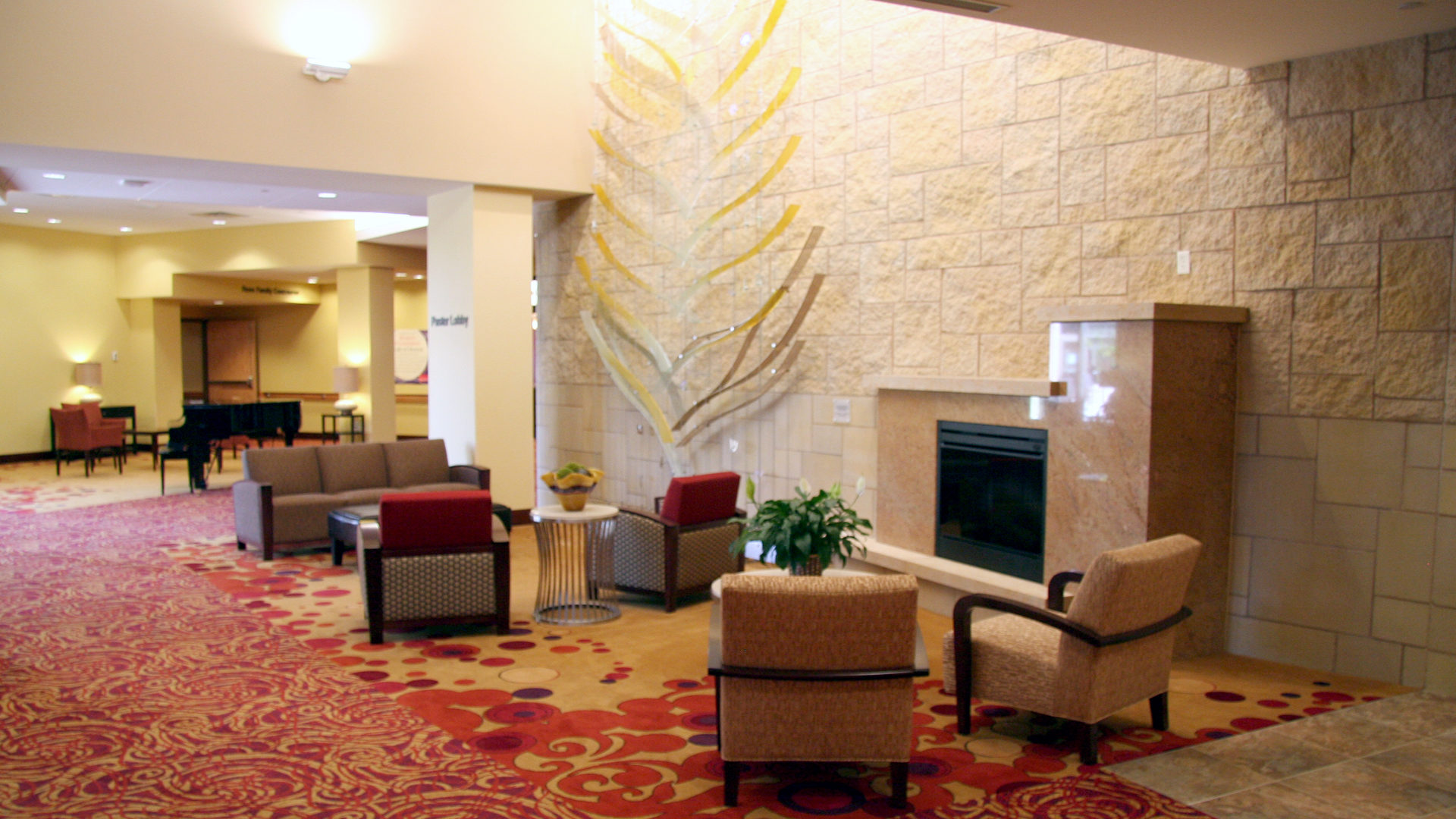 Shaller Sholom East Bentson-Chapman Senior Living Campus St Paul MN Lobby Fireplace Seating Area