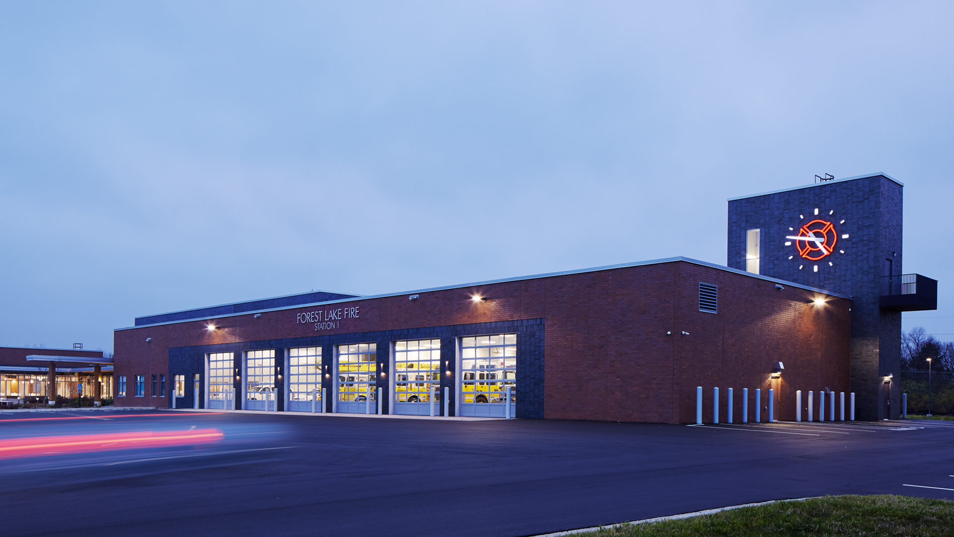 Forest Lake City Center Government Building Exterior Night View Fire Station Bay of Garage Doors