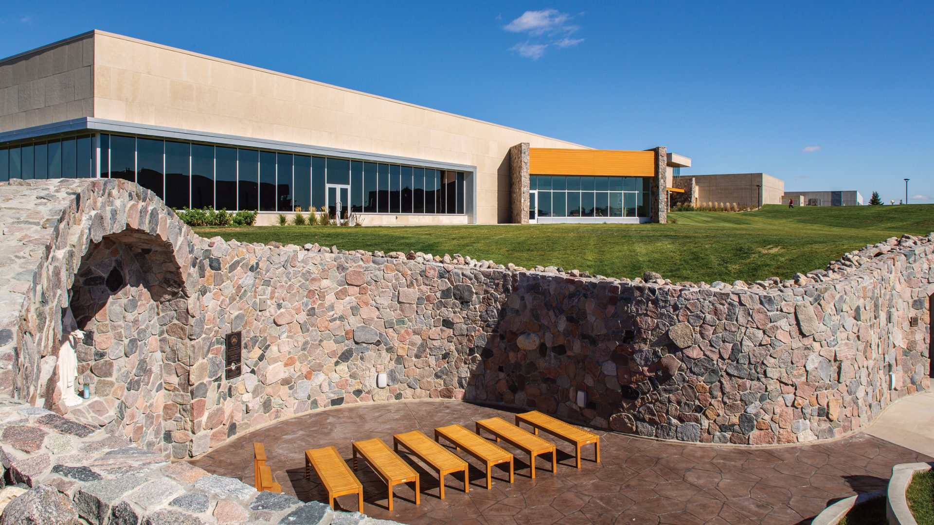 University of Mary Lumen Vitae University Center and McDowell Activity Center Bismarck ND Exterior shot of Marion Grotto looking toward the Center