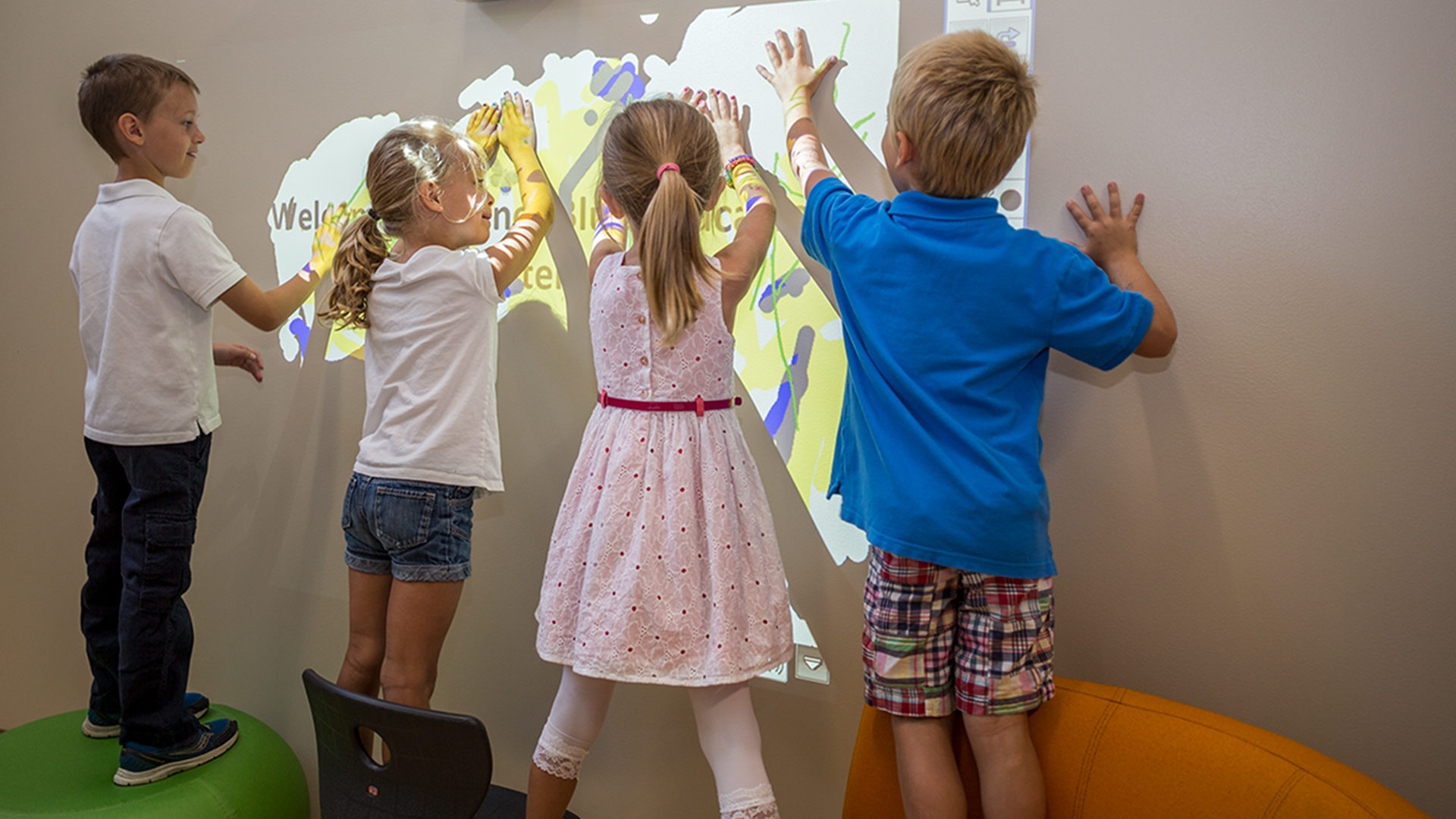 Karner Blue Education Center Blaine Four Kids Play with Projection on the Wall