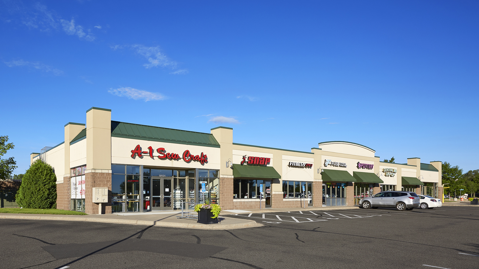 Hayden Lake Square Champlin MN retail shopping center exterior full view