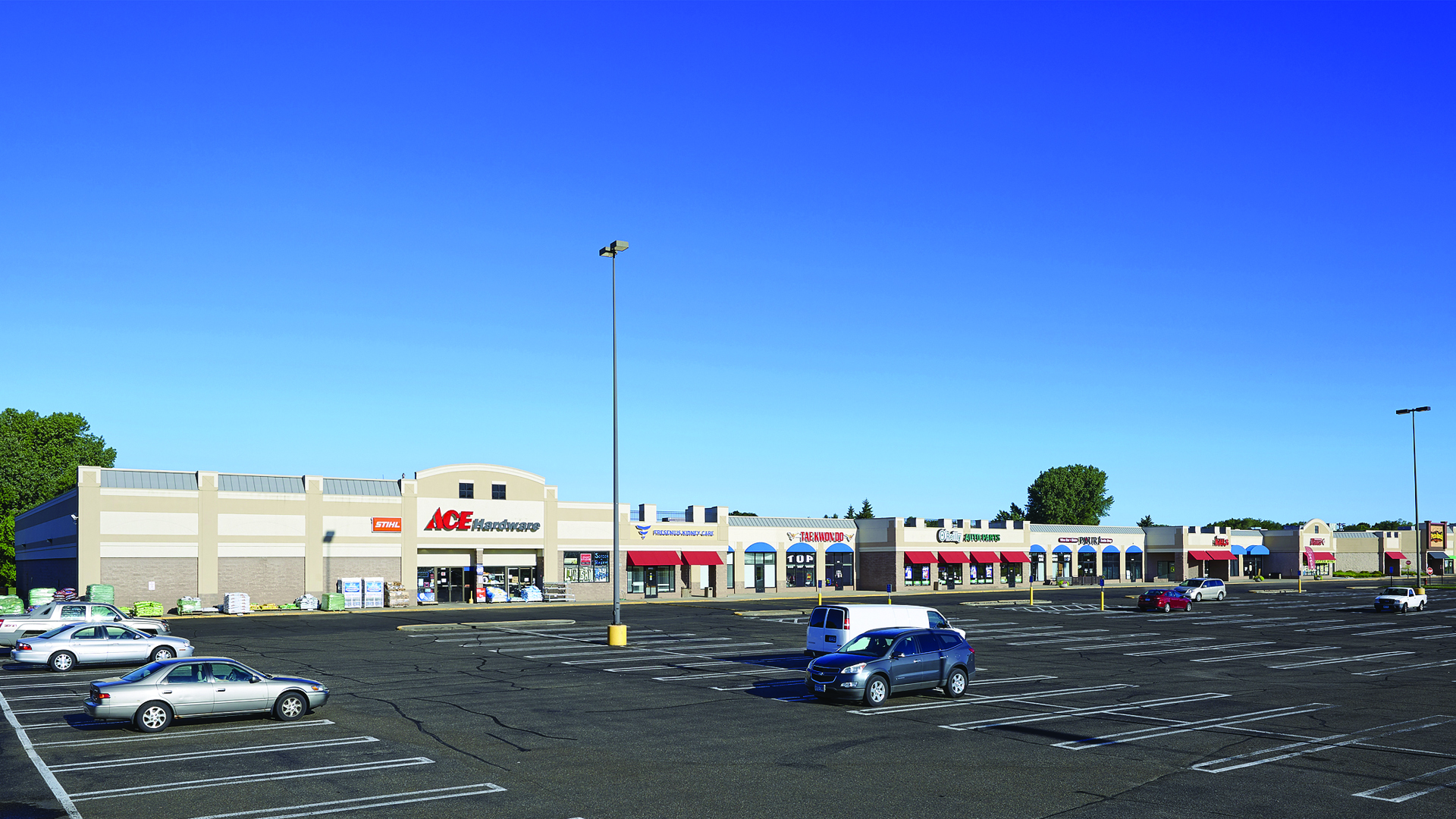 Champlin Plaza Shopping Center Champlin MN View of strip mall featuring anchor ACE Hardware