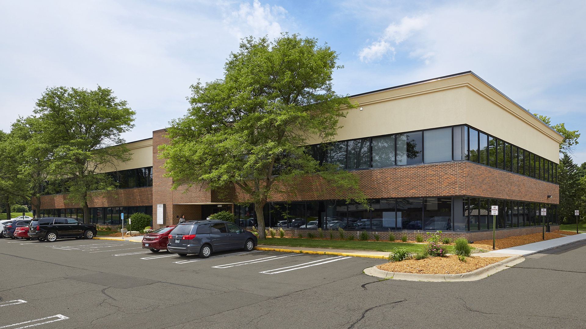 4200 W Old Shakopee Office Building Back Entrance and Surface Parking Lot
