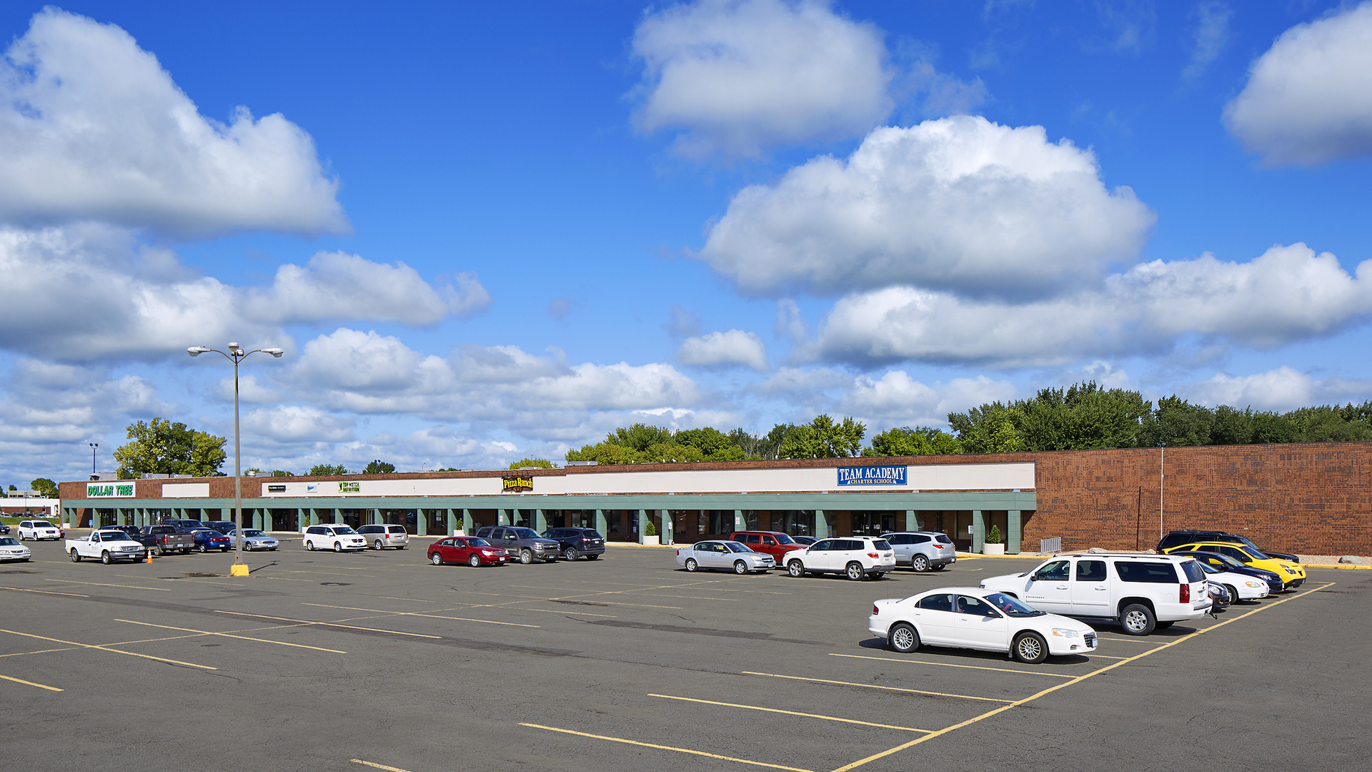 Northridge Plaza Retail Shopping Center Waseca MN exterior full strip mall view