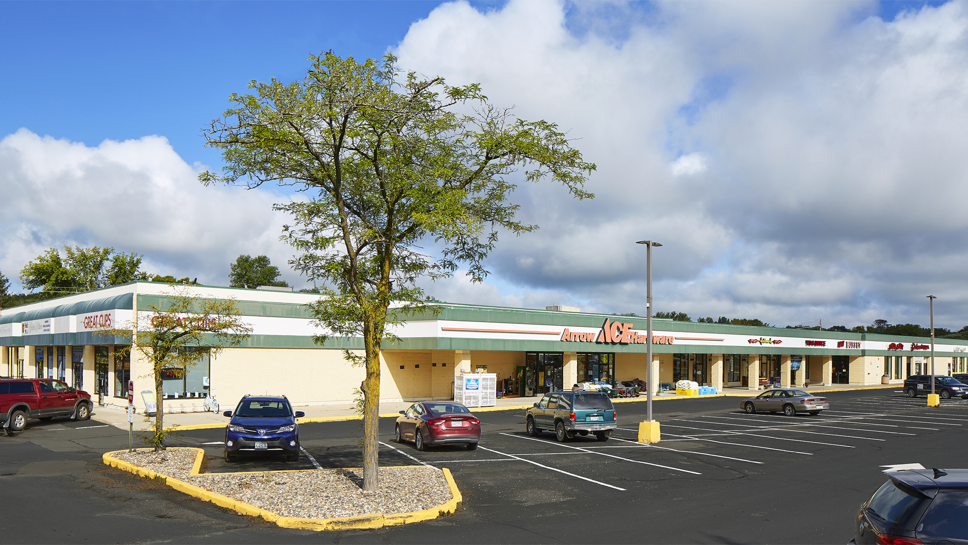 River Park Retail Strip Mall Northfield MN view featuring Ace Hardware