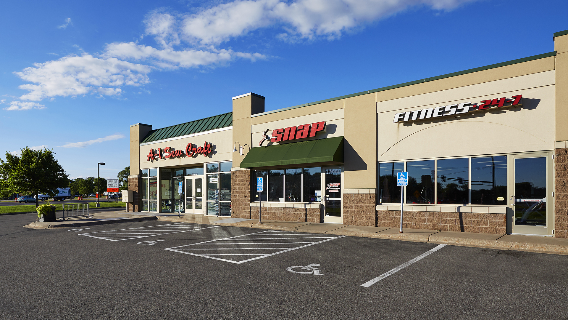 Hayden Lake Square Champlin MN retail shopping center exterior featuring A-1 Sewing and Snap Fitness