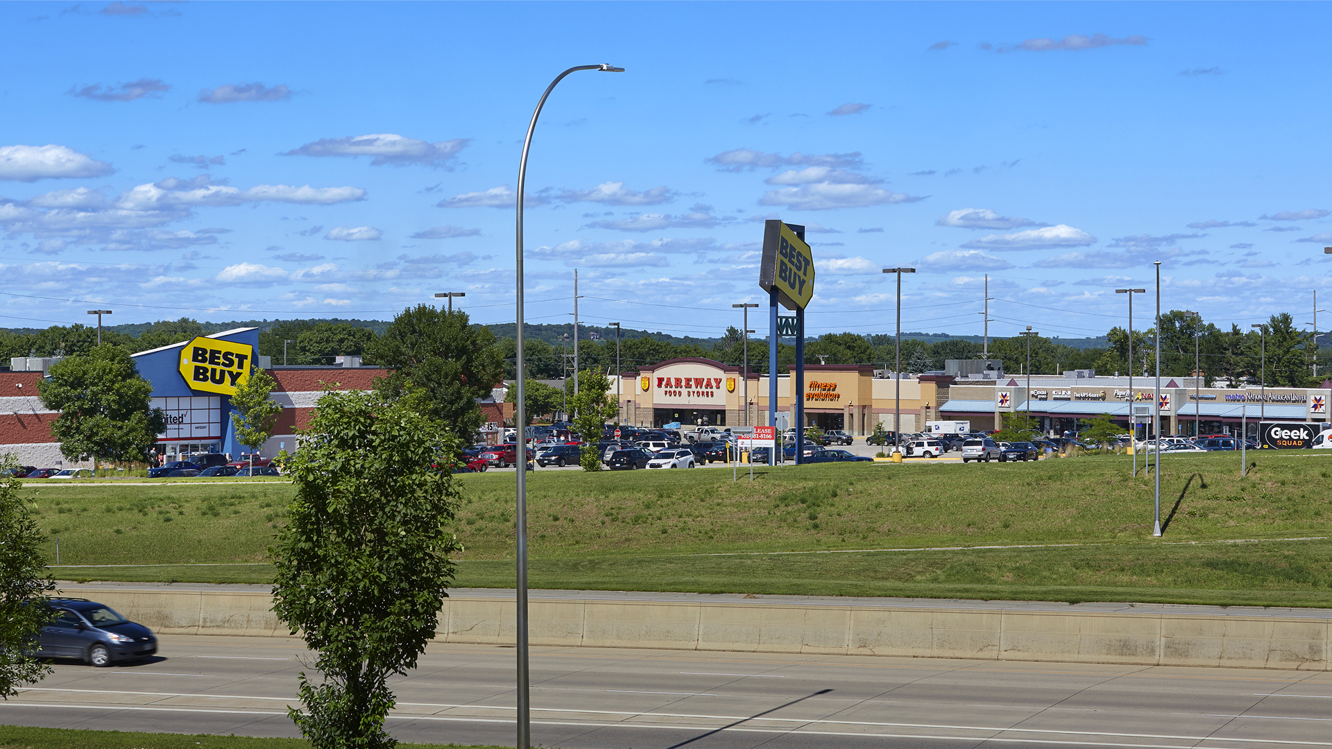 Maplewood Square Retail Shopping Center Rochester MN exterior view shot from across the highway