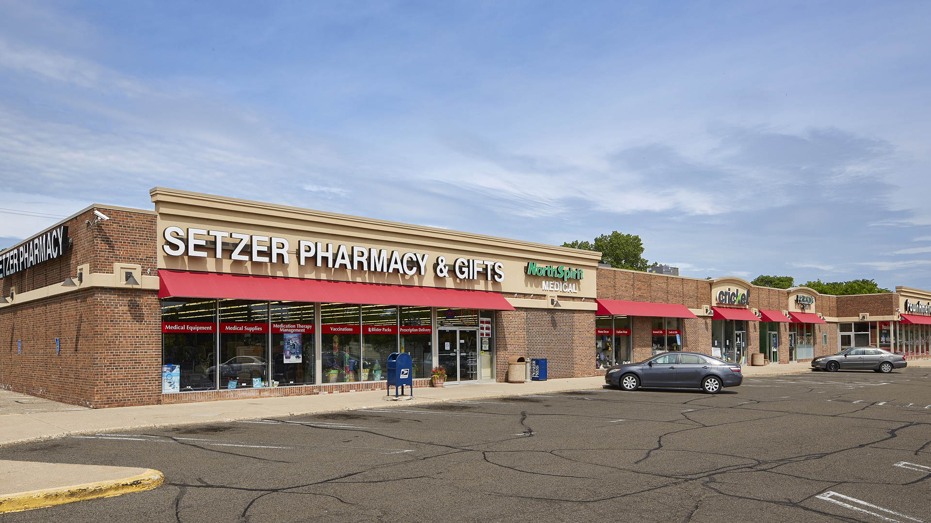 McCarron Hills Retail Shopping Center Roseville MN exterior view featuring Setzer Pharmacy