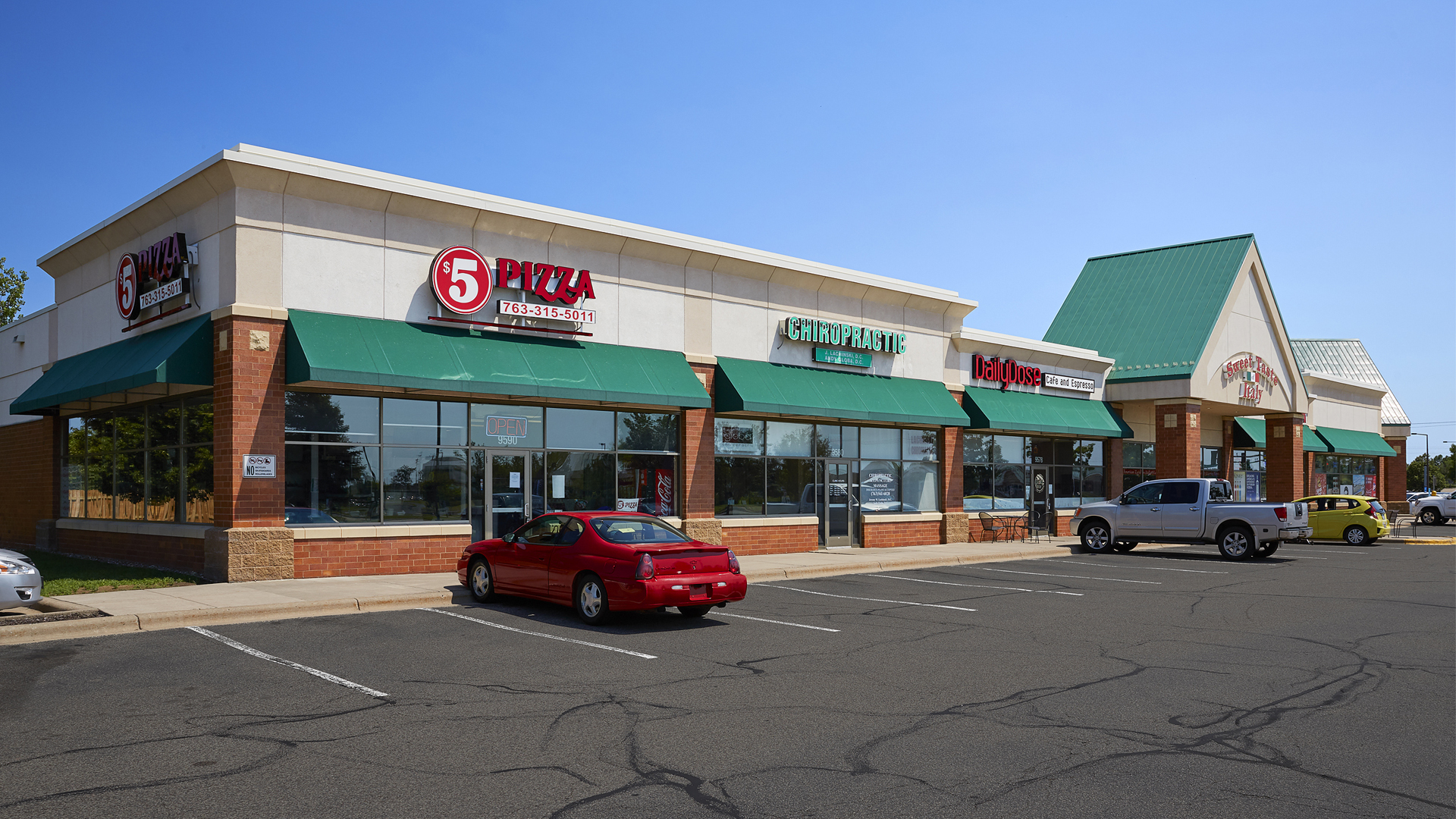 Pinebrook Centre Brooklyn Park MN retail strip mall exterior featuring 5 Pizza and Sweet Taste Italy