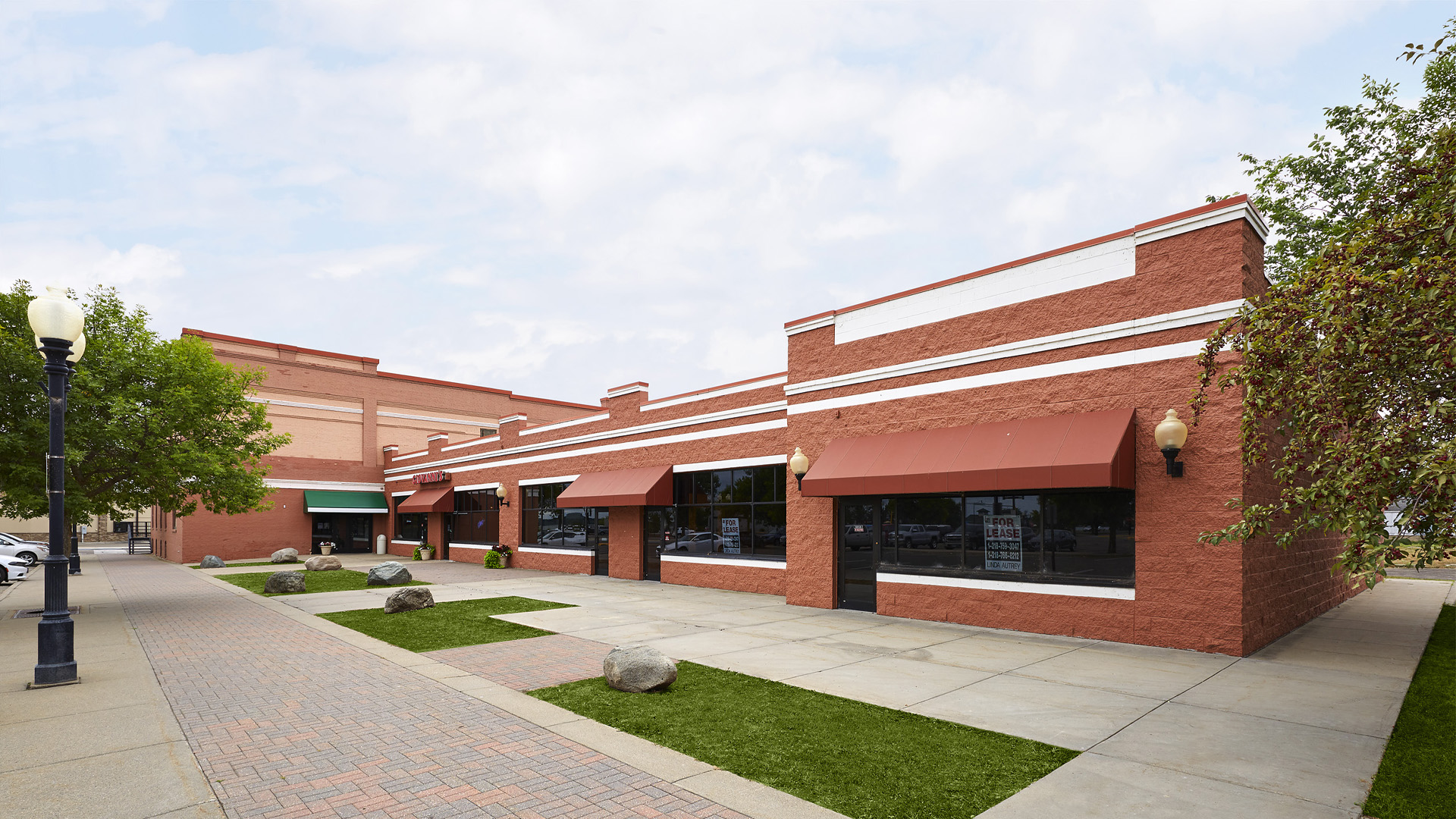 Union Square Shopping Center Bemidji MN small retail strip connected Mayflower office building
