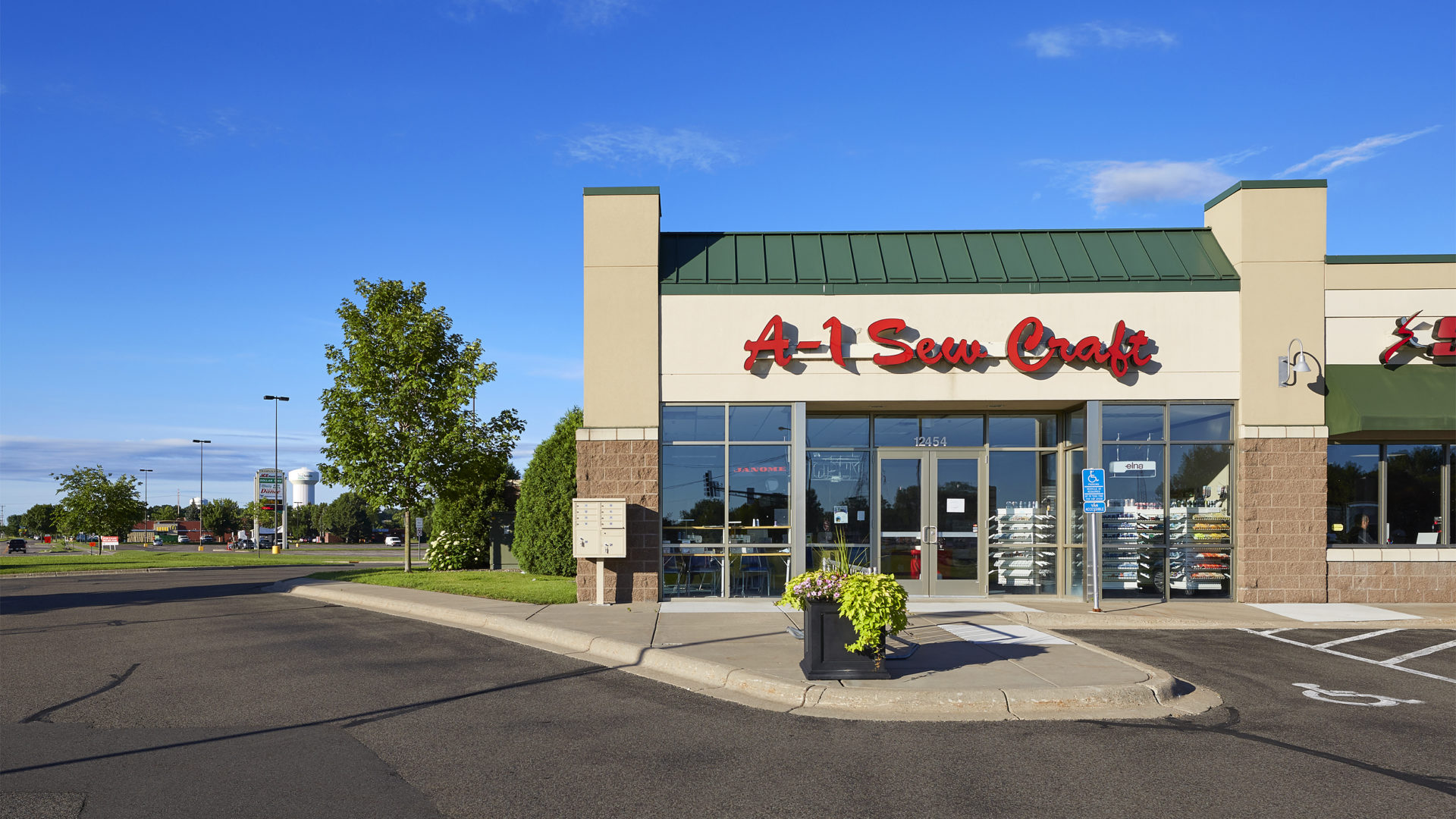 Hayden Lake Square Champlin MN retail shopping center exterior featuring A-1 Sewing eastern end cap