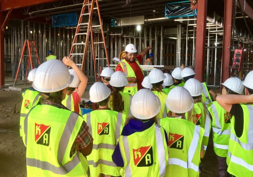 Touring students at Lino Lakes school job site