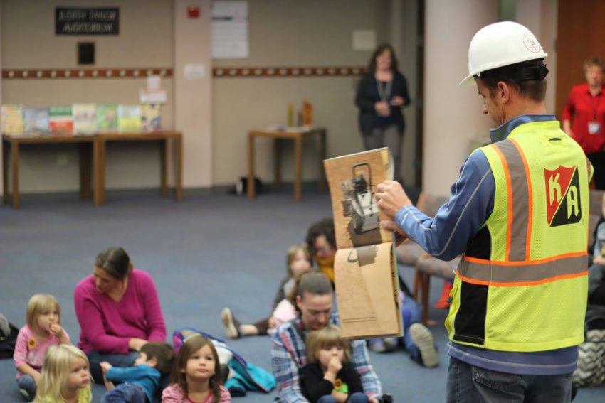 Project superintendent reading to school children at Children's Museum Rochester MN