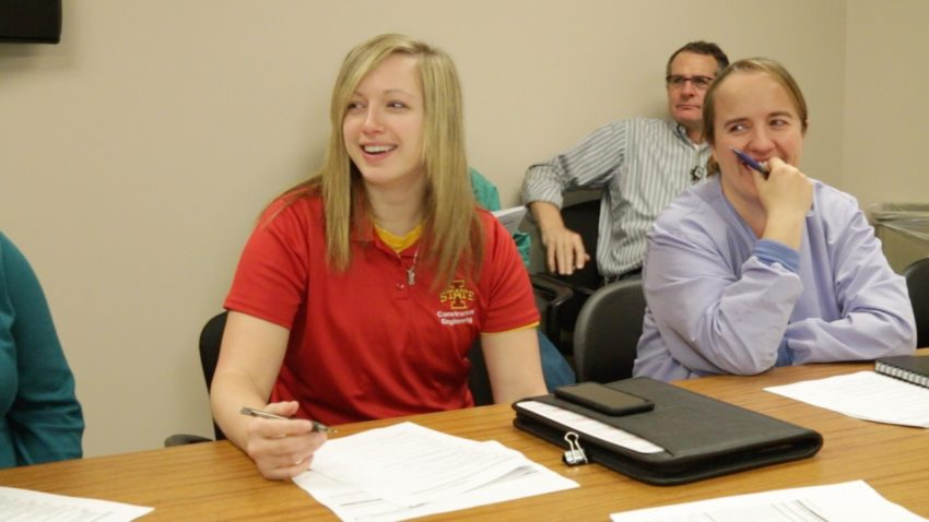 a young woman leads a healthcare team site meeting