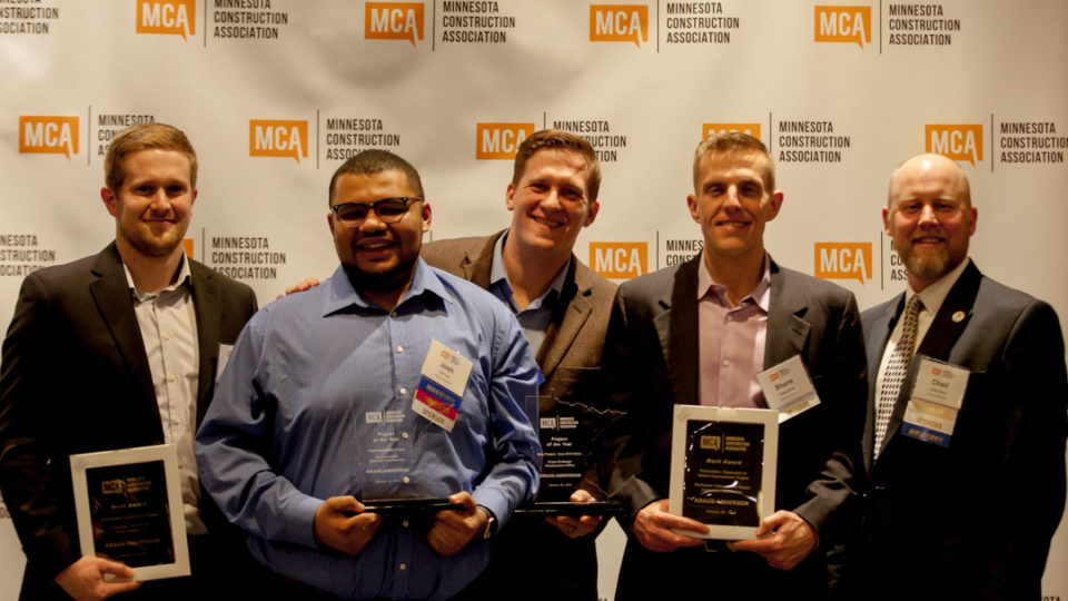Kraus-Anderson attendees with the awards and event emcee Chad Rettke.