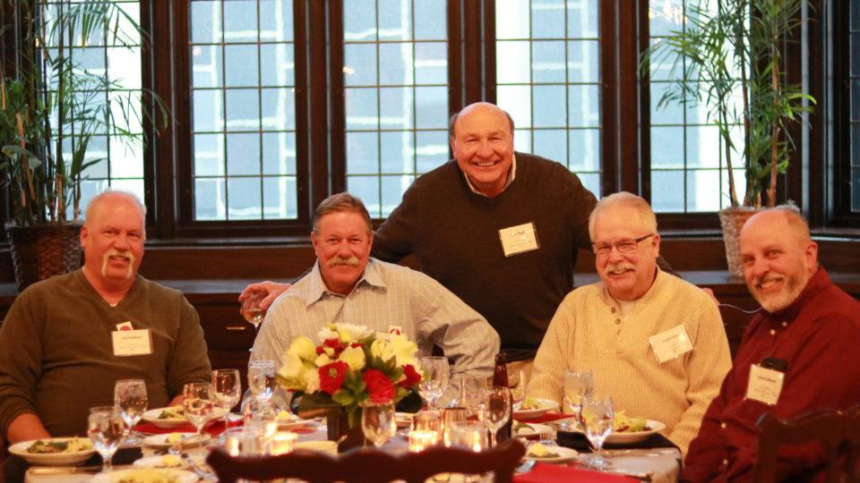 Five gentlemen enjoying the KA Silver Service dinner.