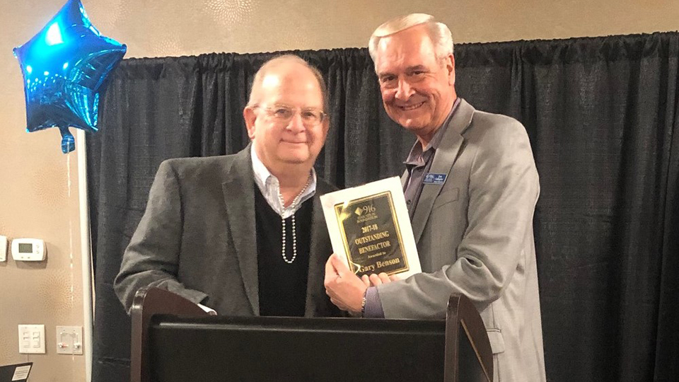 Gary Benson receiving award for Outstanding Benefactor District 916