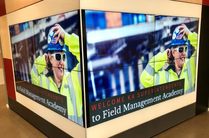 Tech wall promoting Field Management Academy