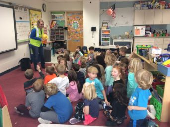 Krystal Burton talks about construction careers with a kindergarten class