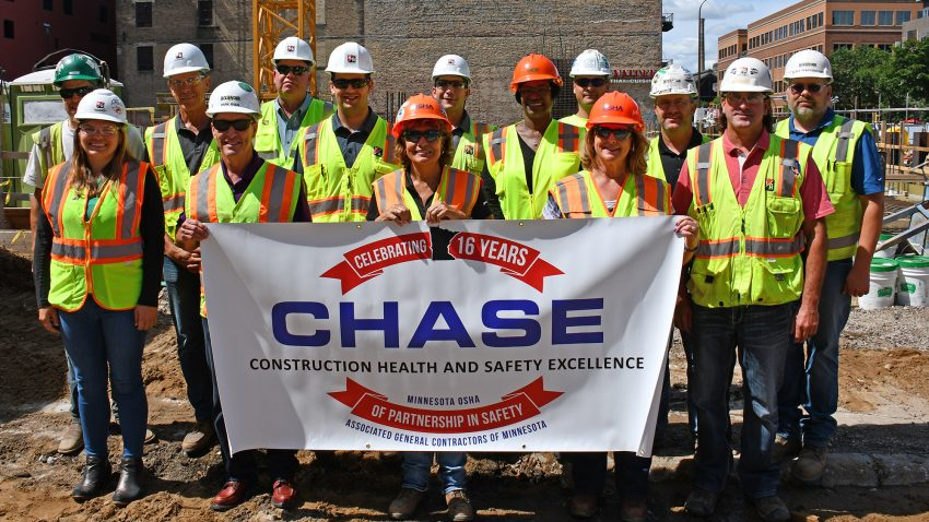 Diverse project team with OSHA CHASE Safety banner