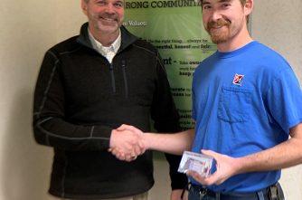 Bob Fitzgerald presents the Core Values award to Pat Wavrin.