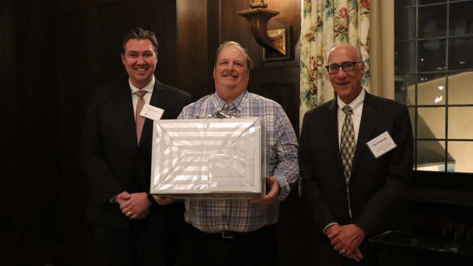 KA Realty President Peter Diessner and Bruce Engelsma present the Silver Service award to Joel Kildahl