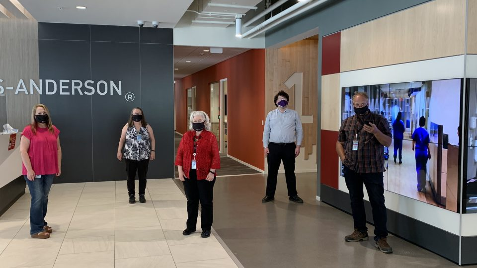 KA employees in lobby wearing face masks. COVID-19 office work