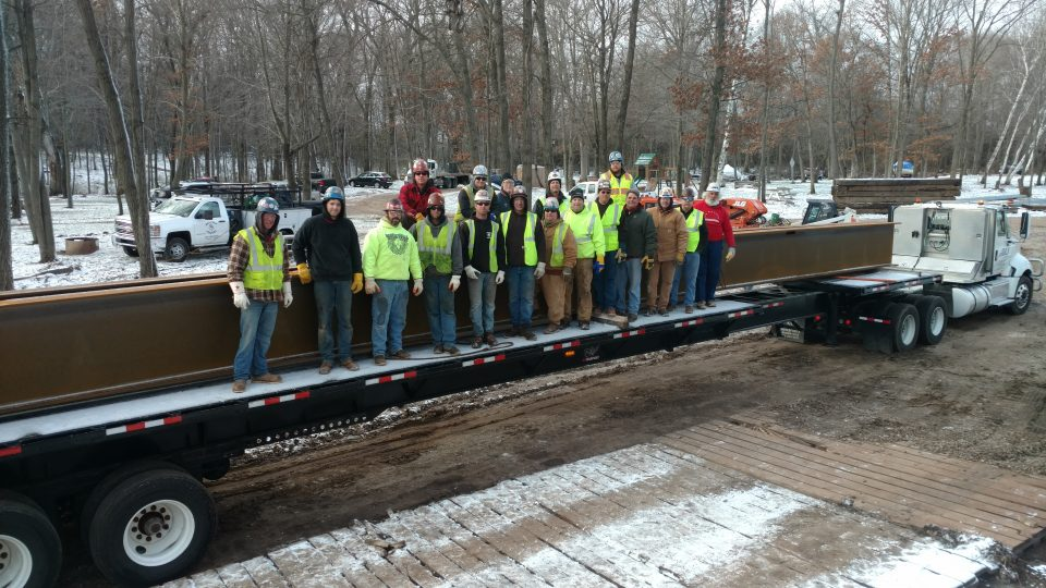 Iron worker volunteers built a steel bridge at the Veterans Camp in Marine on St. Croix. at